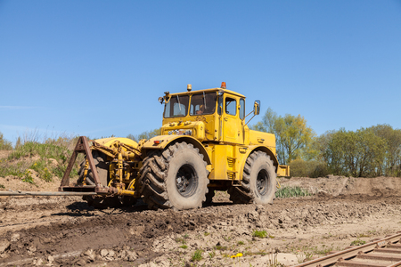 farm duties: GRIMMEN  GERMANY - MAY 5, 2016: Russian Kirowez K 700 tractor on a track in grimmen, germany on may 5, 2016.