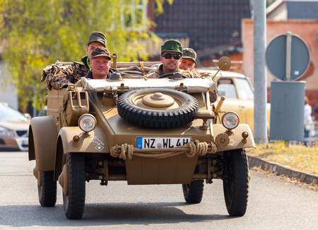 ALTENTREPTOW  GERMANY - MAY 1, 2016: german kubelwagen, vw typ 82 drives on an oldtimer show in altentreptow, germany at may 1, 2016. Editorial
