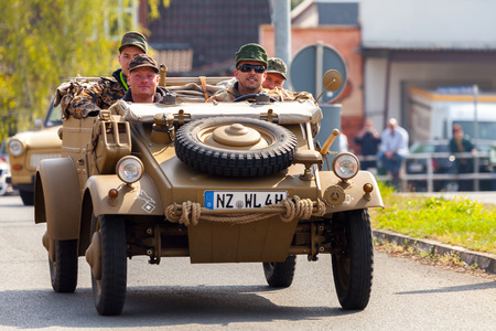 typ: ALTENTREPTOW  GERMANY - MAY 1, 2016: german kubelwagen, vw typ 82 drives on an oldtimer show in altentreptow, germany at may 1, 2016. Editorial