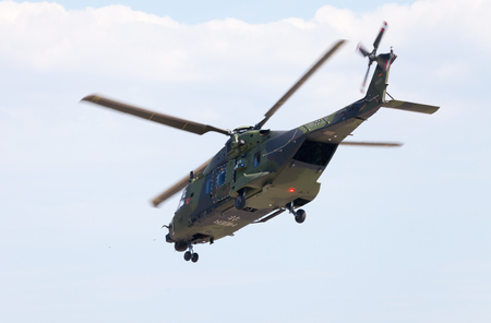 nato: BERLIN  GERMANY - JUNE 3 2016: tactical troop helicopter NH90 from nato helicopter industries flies in berlin, germany on june 3, 2016. Editorial