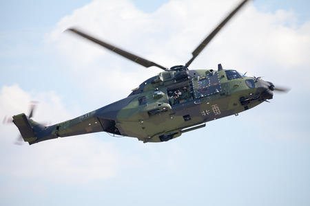 troop: BERLIN  GERMANY - JUNE 3 2016: tactical troop helicopter NH90 from nato helicopter industries flies in berlin, germany on june 3, 2016. Editorial