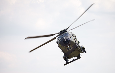 heli: BERLIN  GERMANY - JUNE 3 2016: tactical troop helicopter NH90 from nato helicopter industries flies in berlin, germany on june 3, 2016. Editorial
