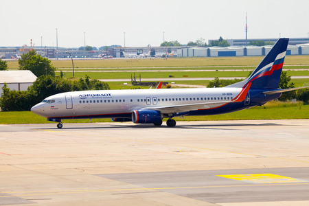 boing: BERLIN  GERMANY - JUNE 4, 2016: Aeroflot - Russian Airlines Boeing 737-8LJ (WL) plane drives to the terminal on airport schoenefeld, berlin  germany at june 4, 2016