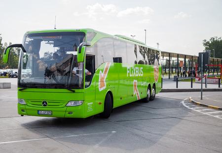busses: BERLIN  GERMANY - JUNE 4, 2016: german mercedes benz bus from flixbus arrives the airport in schoenefeld, berlin  germany at june 4, 2016.