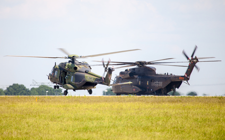 ch: BERLIN  GERMANY - JUNE 3, 2016:  german military transport helicopters, nh 90 and ch 53 lands on airfield in berlin, germany at june 3, 2016.