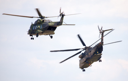 ch: BERLIN  GERMANY - JUNE 3, 2016: german military transport helicopters, nh 90 and ch 53 flights in the sky in berlin  germany at june 3, 2016. Editorial