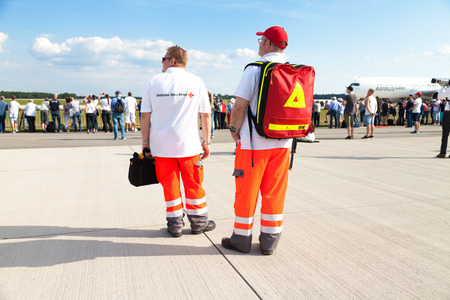 paramedics: BERLIN  GERMANY - JUNE 3, 2016: german paramedics from deutsches rotes kreuz, stands on airport berlin, germany at june 3, 2016. Editorial