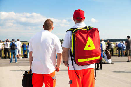 paramedics: two german paramedics stands on an airfield Stock Photo