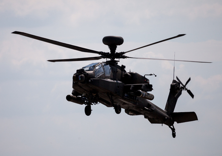 apache: BERLIN  GERMANY - JUNE 3, 2016: Boing AH-64 Apache flights on airport schoenefeld, berlin  germany at june 3, 2016 Editorial