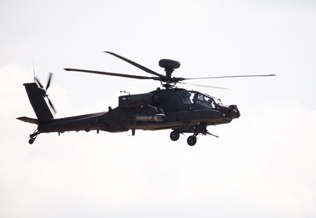 boing: BERLIN  GERMANY - JUNE 3, 2016: Boing AH-64 Apache flights on airport schoenefeld, berlin  germany at june 3, 2016 Editorial