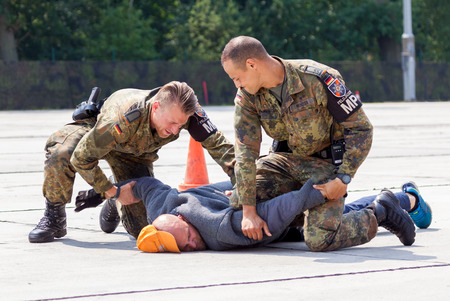 assassin: BURG  GERMANY - JUNE 25, 2016: german military police bodyguards defeats an assassin on an exercise in burg  germany at june 25, 2016