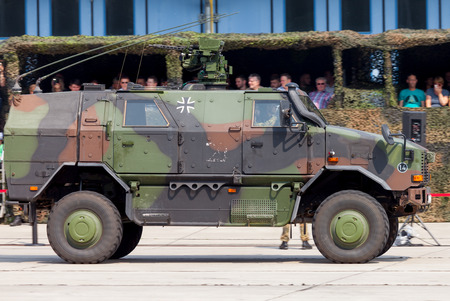 barrack: BURG  GERMANY - JUNE 25, 2016: german armored military infantry mobility vehicle, ATF Dingo drives on open day in barrack burg  germany at june 25, 2016