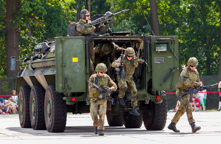 armoured: BURG  GERMANY - JUNE 25, 2016: german military armoured personnel carrier, Fuchs Fox drives on open day in barrack burg  germany at june 25, 2016