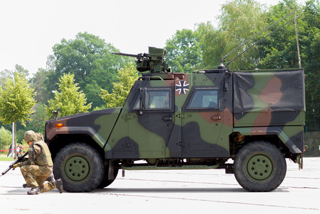 barrack: BURG  GERMANY - JUNE 25, 2016: german army transporter, mowag eagle IV drives on open day in barrack burg  germany at june 25, 2016