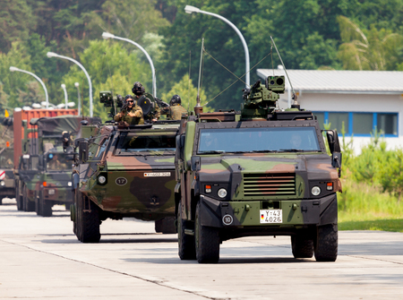 convoy: BURG  GERMANY - JUNE 25, 2016: german military army convoy, drives on open day in barrack burg  germany at june 25, 2016