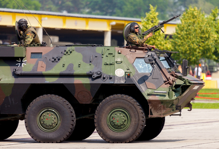 barrack: BURG  GERMANY - JUNE 25, 2016: german military armoured personnel carrier, Fuchs Fox drives on open day in barrack burg  germany at june 25, 2016