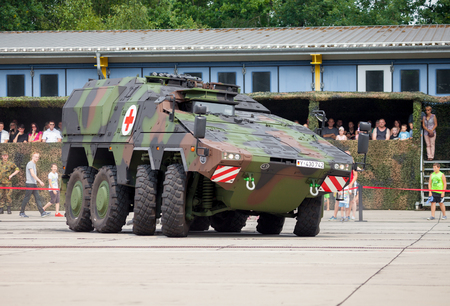 armoured: BURG  GERMANY - JUNE 25, 2016: german armoured ambulance vehicle, Boxer drives on open day in barrack burg  germany at june 25, 2016.