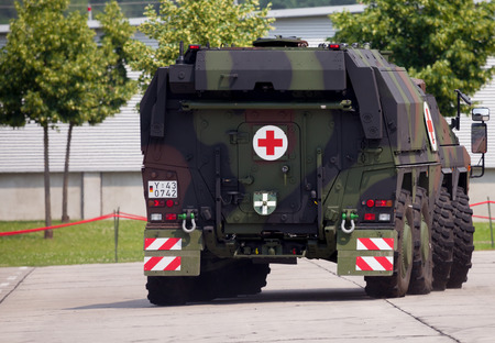 barrack: BURG  GERMANY - JUNE 25, 2016: german armoured ambulance vehicle, Boxer drives on open day in barrack burg  germany at june 25, 2016.