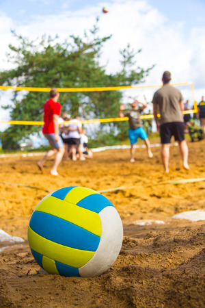 volleyball lies on playing field Foto de archivo