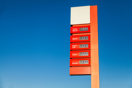 unleaded: red gas station price sign