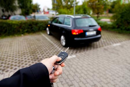 Car key makes a car open Stock Photo