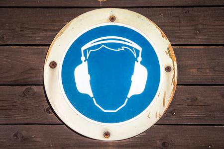 muff: blue ear muff symbol on wood texture