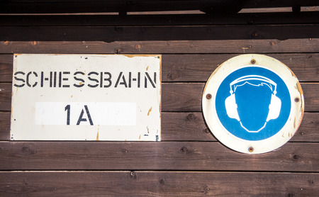 german handgun: german Schiessbahn  shooting range sign with ear muff symbol Stock Photo