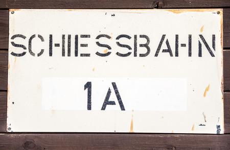 german handgun: german Schiessbahn  shooting range sign