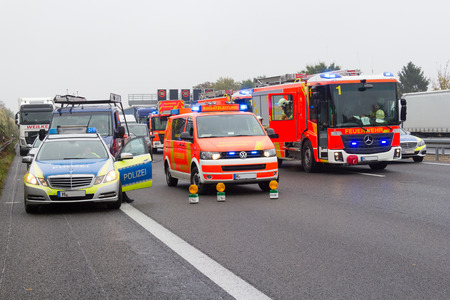 HANNOVER / GERMANY - OCTOBER 25, 2016: german emergency service cars stands on freeway a2  by a truck crash near Hannover. Editorial