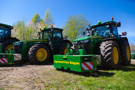 display machine: GRIMMEN  GERMANY - MAY 5, 2016: john deere tractor stands on tractor show in grimmen  germany at may 5, 2016. Editorial
