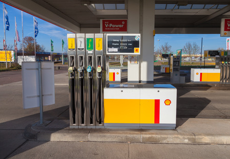 headquartered: BURG  GERMANY - NOVEMBER 13, 2016: Shell gas station sign. Shell is an Anglo-Dutch multinational oil and gas company headquartered in the Netherlands and incorporated in the United Kingdom.