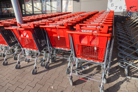 diversified: BURG  GERMANY - NOVEMBER 13, 2016: Shopping carts of the german supermarket chain, REWE stands together in a row. The REWE Group is a German diversified retail and tourism co-operative group.