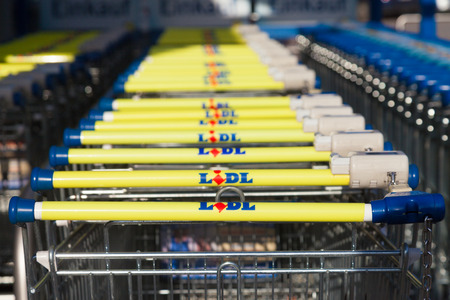 BURG / GERMANY - NOVEMBER 13, 2016: Shopping carts of the german supermarket chain, LIDL stands together in a row. LIDL is a German global discount supermarket chain, based in Neckarsulm, Germany.