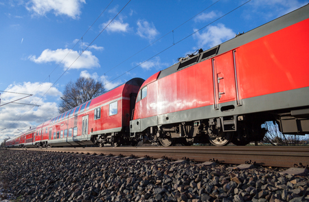 german passenger train drives to the next station Stock Photo