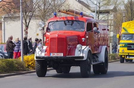 antique fire truck: ALTENTREPTOW  GERMANY - MAY 1, 2016: german mercedes benz fire truck oldtimer drives on a street at oldtimer show on may 1, 2016 in altentreptow, germany. Editorial