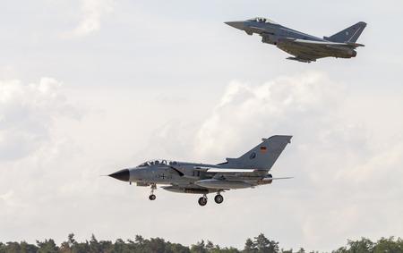 BERLIN  GERMANY - JUNE 3, 2016: german Panavia Tornado and a eurofighter typhoon lands on airport schoenefeld, berlin  germany at june 3, 2016.