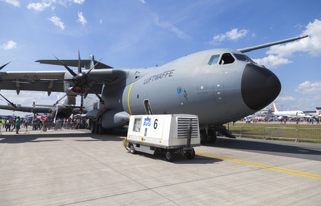 airbus: BERLIN  GERMANY - JUNE 3, 2016: german Airbus A 400 M stands on airport schoenefeld  berlin. The Airbus A400M is a multi-national, four-engine turboprop military transport aircraft.