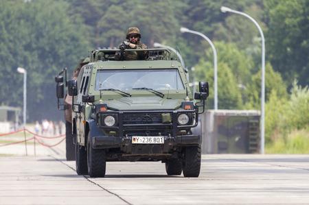BURG  GERMANY - JUNE 25, 2016: german light armoured patrol vehicle Enok, drives on open day in barrack burg  germany at june 25, 2016