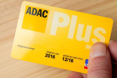truck driver: LANDESBERGEN  GERMANY - MARCH 5, 2017: hand holds an ADAC (german automobile club) club card Editorial