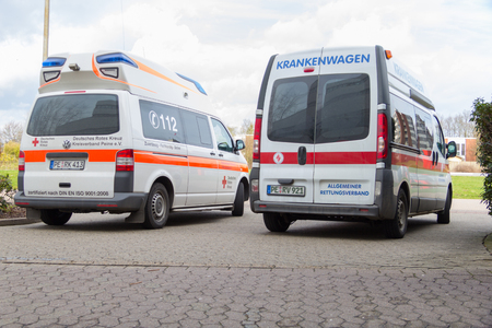 cross street with care: PEINE  GERMANY - MARCH 20, 2017: two german ambulance vehicles stands on hospital at peine  germany