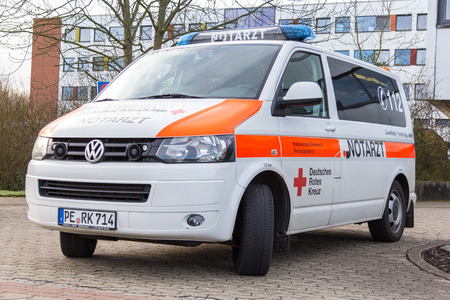 cross street with care: PEINE  GERMANY - MARCH 20, 2017: german emergency doctor ( notarzt ) car stands on a hospital Editorial