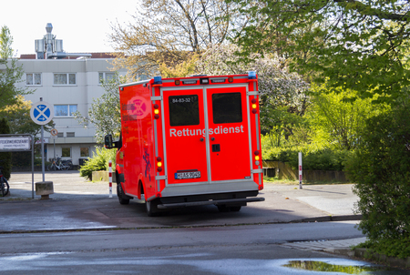 HANNOVER  GERMANY - APRIL 25, 2017: german ambulance stands on street Editorial