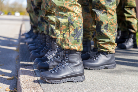 german army shoes in a line Stock Photo