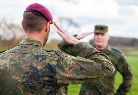 two german soldiers salute each other
