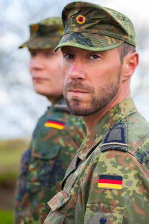 two german soldiers looks to the side Standard-Bild