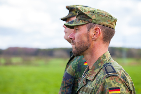 two german soldiers looks to the side Stock Photo