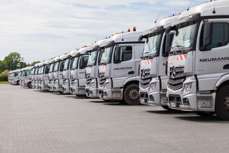 BURG  GERMANY - JUNE 11, 2017: german Mercedes Benz Actros trucks from haulage firm Neumann stands in a row.