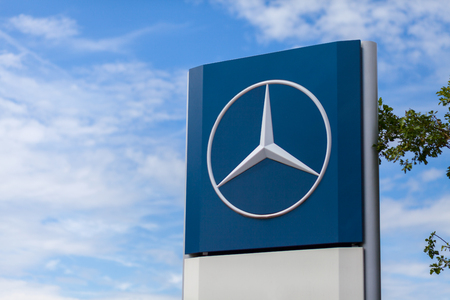 BURG  GERMANY - JUNE 11, 2017: Mercedes-Benz logo near a trucking workshop. Mercedes-Benz is a global automobile manufacturer and a division of the German company Daimler AG.