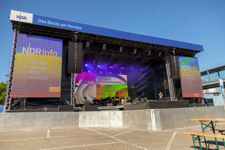 based: KIEL  GERMANY - JUNE 20, 2017: NDR stage on public event Kieler Woche in Germany. Northern German Broadcasting is a public radio and television broadcaster, based in Hamburg. Editorial