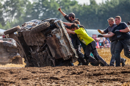 LINSBURG  GERMANY - AUGUST 05, 2017: people on a Stockcar on a dirty track at a Stockcar challenge. Editorial